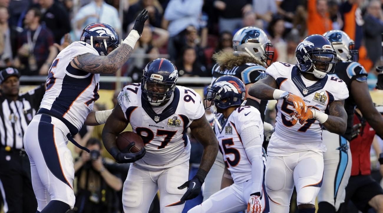 Denver Broncos' Malik Jackson (97) celebrates after scoring a touchdown during the first half of the NFL Super Bowl 50 football game Sunday, Feb. 7, 2016, in Santa Clara, Calif. (AP Photo/Jeff Chiu)