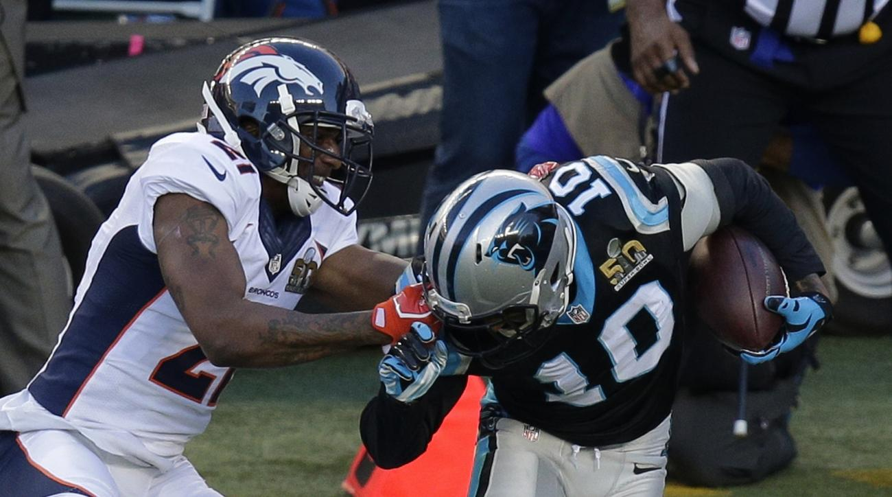 Denver Broncos' Aqib Talib (21) grabs the face mask of Carolina Panthers' Corey Brown (10) after a catch during the first half of the NFL Super Bowl 50 football game Sunday, Feb. 7, 2016, in Santa Clara, Calif. (AP Photo/Charlie Riedel)