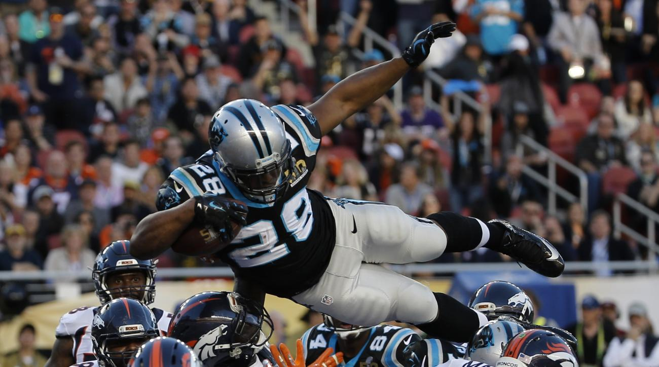 Carolina Panthers' Jonathan Stewart (28) scores a touchdown against the Denver Broncos during the first half of the NFL Super Bowl 50 football game Sunday, Feb. 7, 2016, in Santa Clara, Calif. (AP Photo/Matt Slocum)