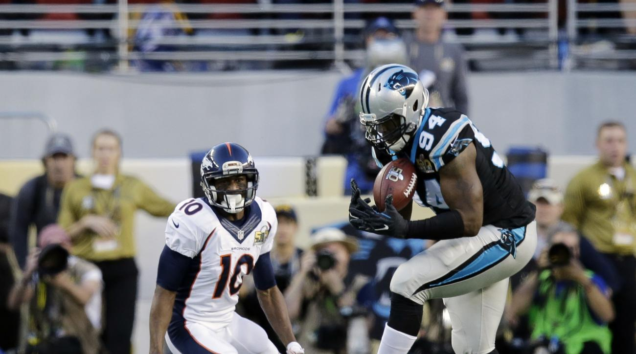 Carolina Panthers' Kony Ealy (94) intercepts a pass during the first half of the NFL Super Bowl 50 football game Sunday, Feb. 7, 2016, in Santa Clara, Calif. At left is Denver Broncos Emmanuel Sanders (10). (AP Photo/Jeff Chiu)