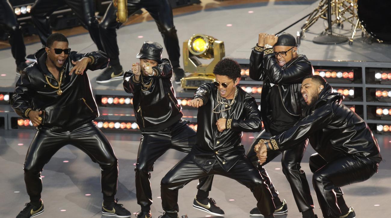 Bruno Mars performs during halftime of the NFL Super Bowl 50 football game Sunday, Feb. 7, 2016, in Santa Clara, Calif. (AP Photo/Charlie Riedel)