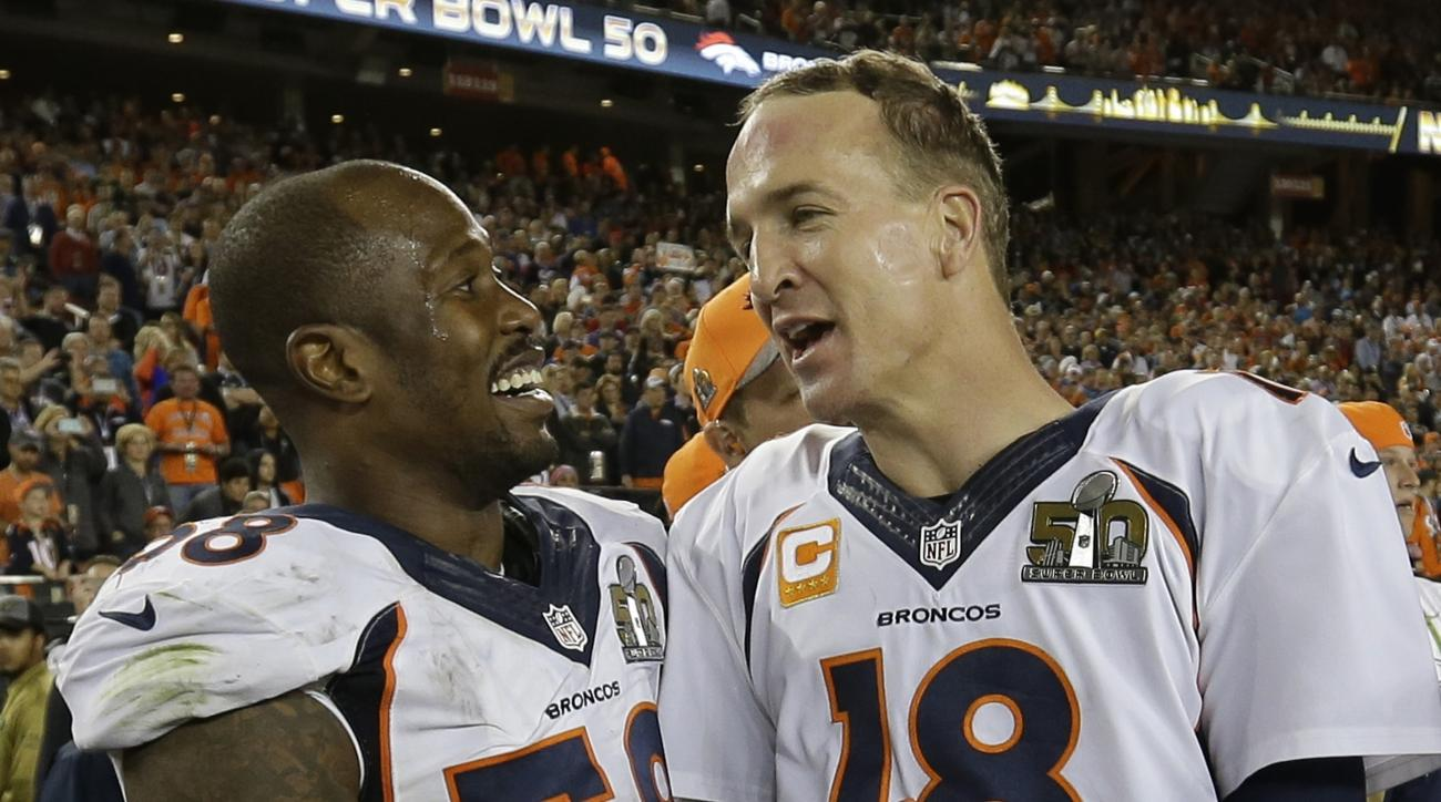 Denver Broncos' Von Miller (58) and Peyton Manning (18) celebrate after the NFL Super Bowl 50 football game Sunday, Feb. 7, 2016, in Santa Clara, Calif. The Broncos beat the Panthers 24-10. (AP Photo/David J. Phillip)