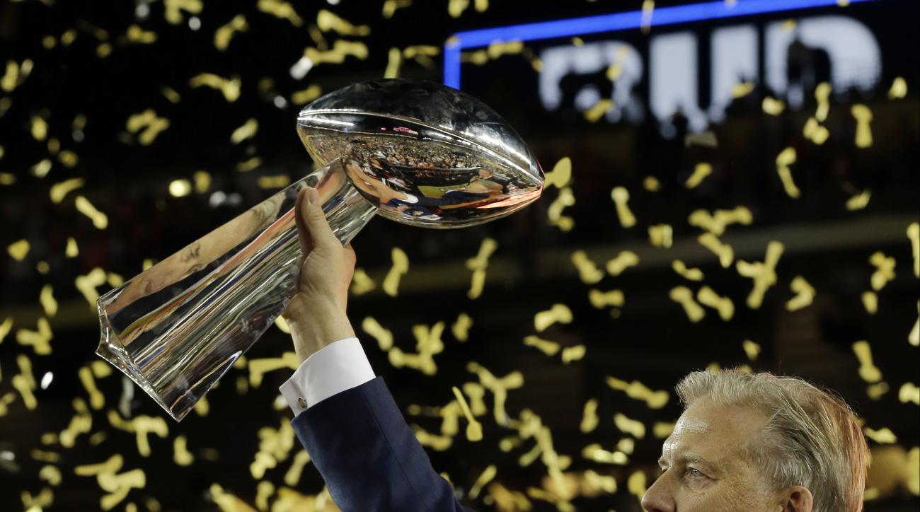 John Elway, General Manager and Executive Vice President of Football Operations for the Denver Broncos, holds the championship trophy after the NFL Super Bowl 50 football game Carolina Panthers Sunday, Feb. 7, 2016, in Santa Clara, Calif. The Broncos won