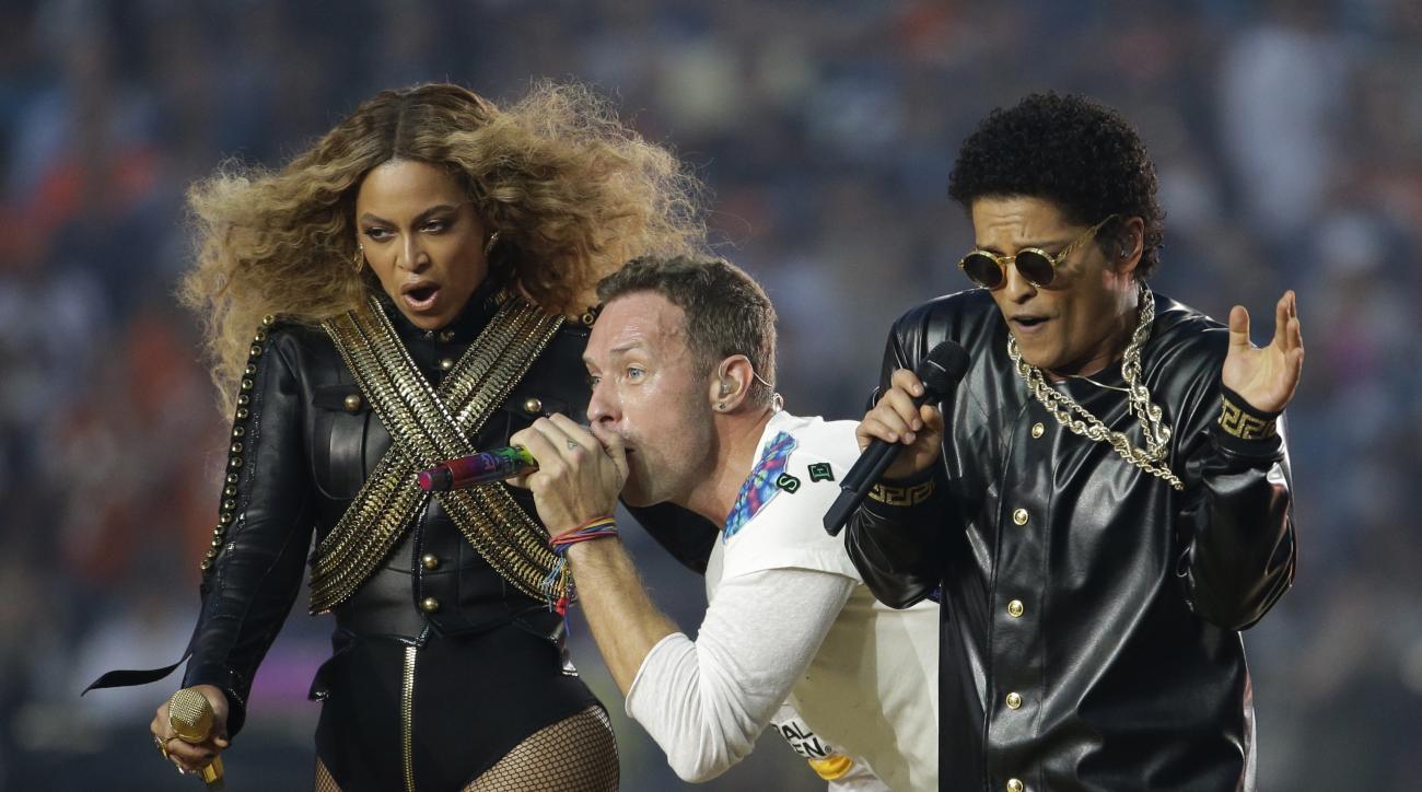 Beyonc, Coldplay singer Chris Martin and Bruno Mars perform during halftime of the NFL Super Bowl 50 football game Sunday, Feb. 7, 2016, in Santa Clara, Calif. (AP Photo/Julio Cortez)
