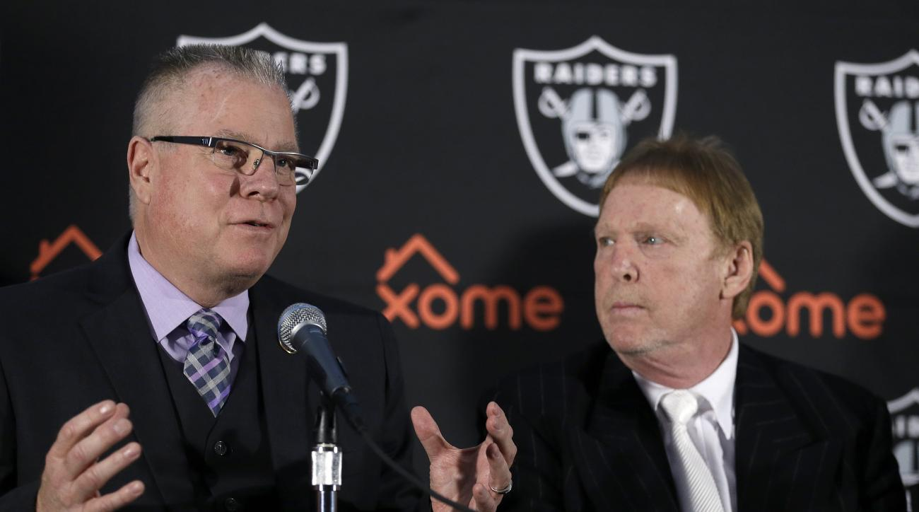 Oakland Coliseum Joint Powers Authority member and Alameda County Supervisor Scott Haggerty, left, gestures beside Oakland Raiders Owner Mark Davis during a media conference Thursday, Feb. 11, 2016, in Oakland, Calif. With the Oakland Raiders' long-term p