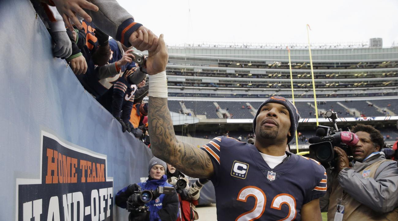 FILE - In this Jan. 3, 2016 file photo, Chicago Bears running back Matt Forte reaches up to fans fans after an NFL football game against the Detroit Lions in Chicago. Forte, a two-time Pro Bowl running back announced on Instagram Friday, Feb. 12, 2016, mo