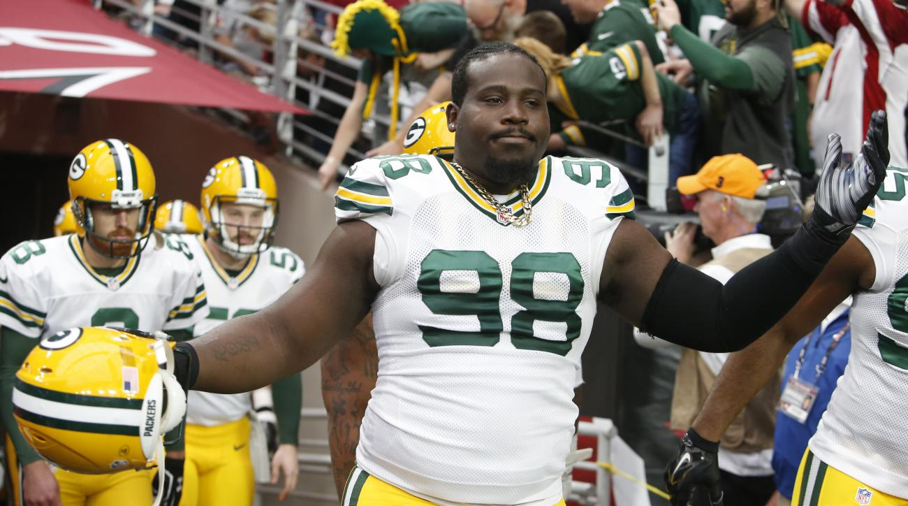 FILE - In this Dec. 27, 2015, file photo, Green Bay Packers nose tackle Letroy Guion (98) gestures during an NFL football game against the Arizona Cardinals, in Glendale, Ariz. The Green Bay Packers have re-signed defensive tackle Letroy Guion, a move tha