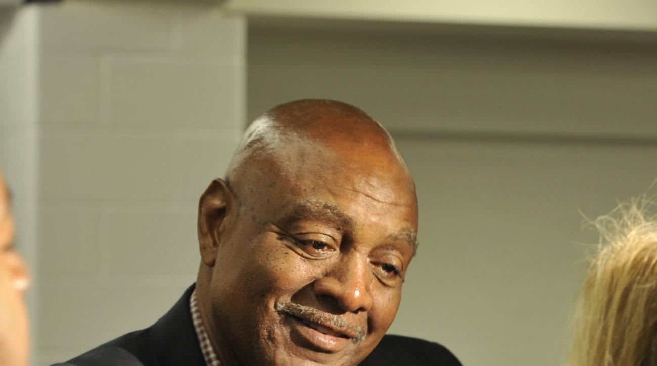 FILE_This Wednesday, May 29, 2013,  file photo shows former NFL player Reggie Rucker after a news conference for Hall of Fame running back Jim Brown, in Cleveland. Rucker, who had roles with two inner-city organizations in Cleveland has been charged in fe