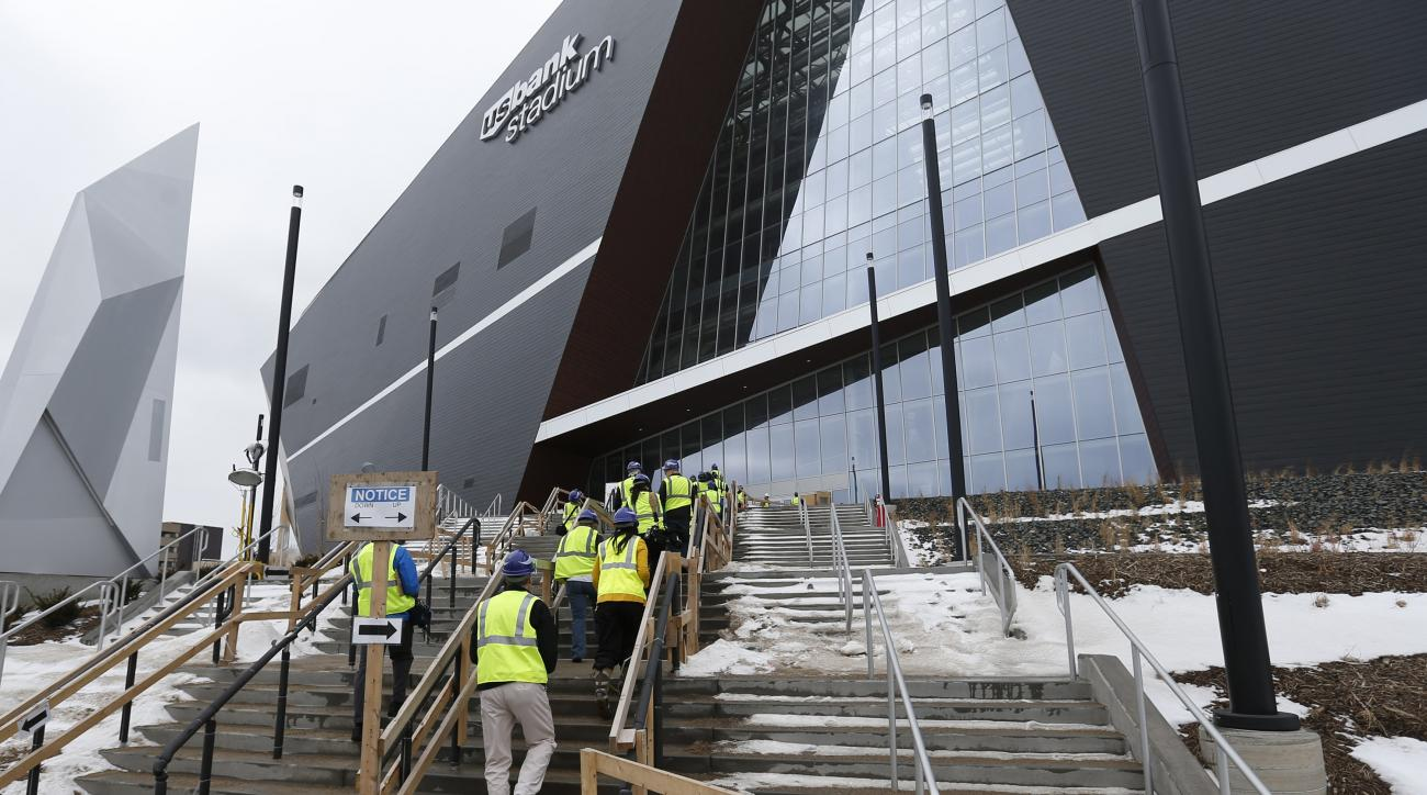 Media members climb the steps during a tour, Tuesday, Feb. 16, 2016, of the new U.S. Bank stadium in Minneapolis which will be home to the Minnesota Vikings NFL football team. (AP Photo/Jim Mone)