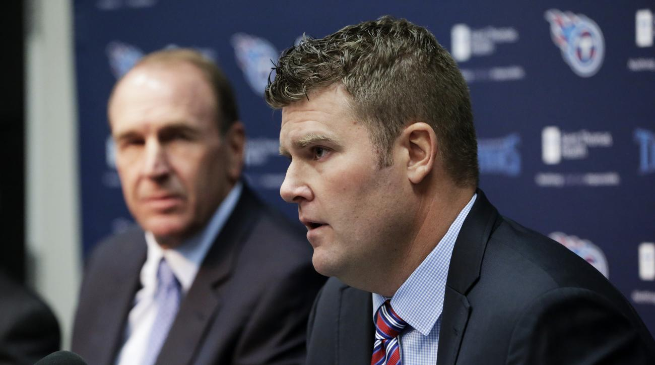 FILE - In this Jan. 18, 2016, file photo, Tennessee Titans general manager Jon Robinson, right, and head coach Mike Mularkey answer questions at a news conference in Nashville, Tenn. Jon Robinson has been very busy since being hired as Tennessee's new gen