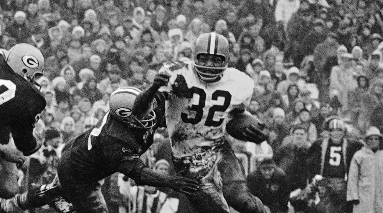 FILE - In this Jan. 2, 1966,  file photo, Cleveland Browns' Jim Brown (32) turns the corner as a Green Bay Packer defender swings with him during a football game in Green Bay, Wisc. The greatest Cleveland Brown of them all is being immortalized.  Hall of