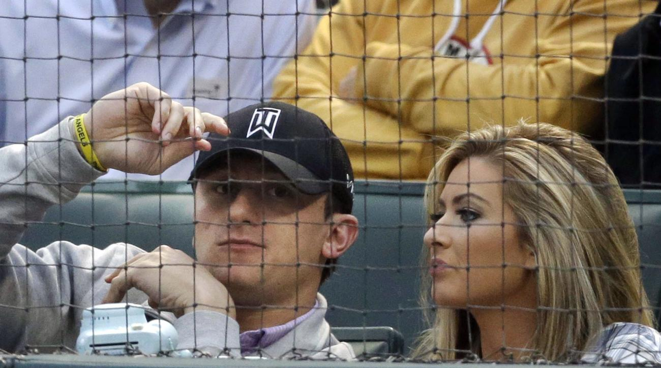 FILE  In this April 14, 2015, file photo, Cleveland Browns quarterback Johnny Manziel, left, sits with Colleen Crowley during a baseball game between the Los Angeles Angels and the Texas Rangers in Arlington, Texas. Dallas police said Saturday, Feb. 20, 2
