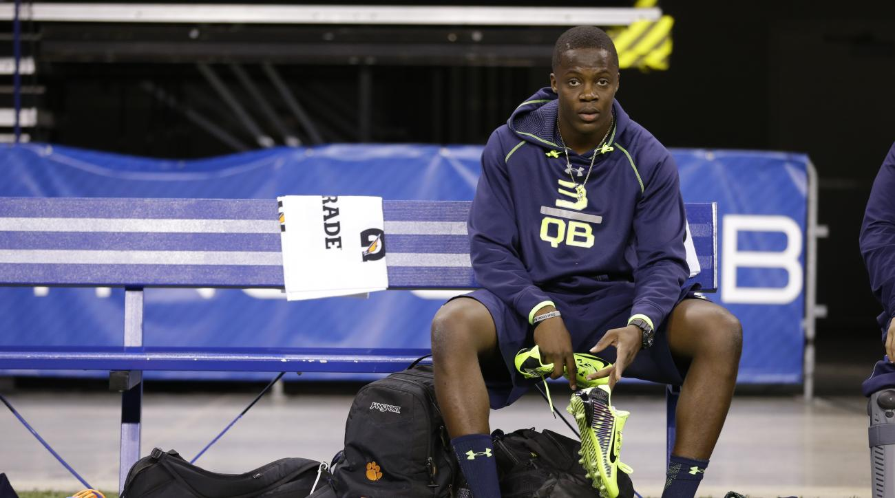 FILE - In this Feb. 23, 2014, file photo, Louisville quarterback Teddy Bridgewater sits on the bench at the NFL football scouting combine in Indianapolis. In 2014, quarterback Teddy Bridgewater decided not to throw in Indy then had a less-than-stellar Pro