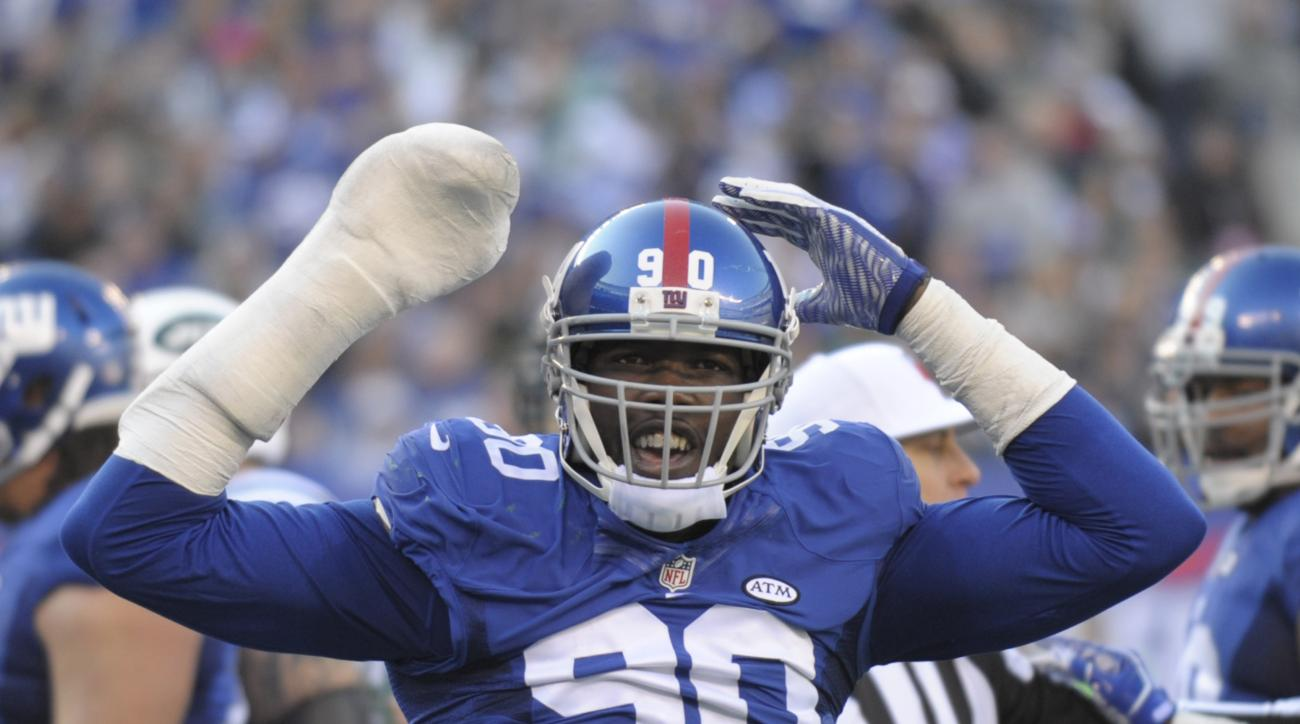 FILE - In this Dec. 6, 2015, file photo, New York Giants defensive end Jason Pierre-Paul reacts during the Giants' NFL football game against the New York Jets in East Rutherford, N.J. Pierre-Paul has filed a lawsuit seeking in more than $15,000 in damages