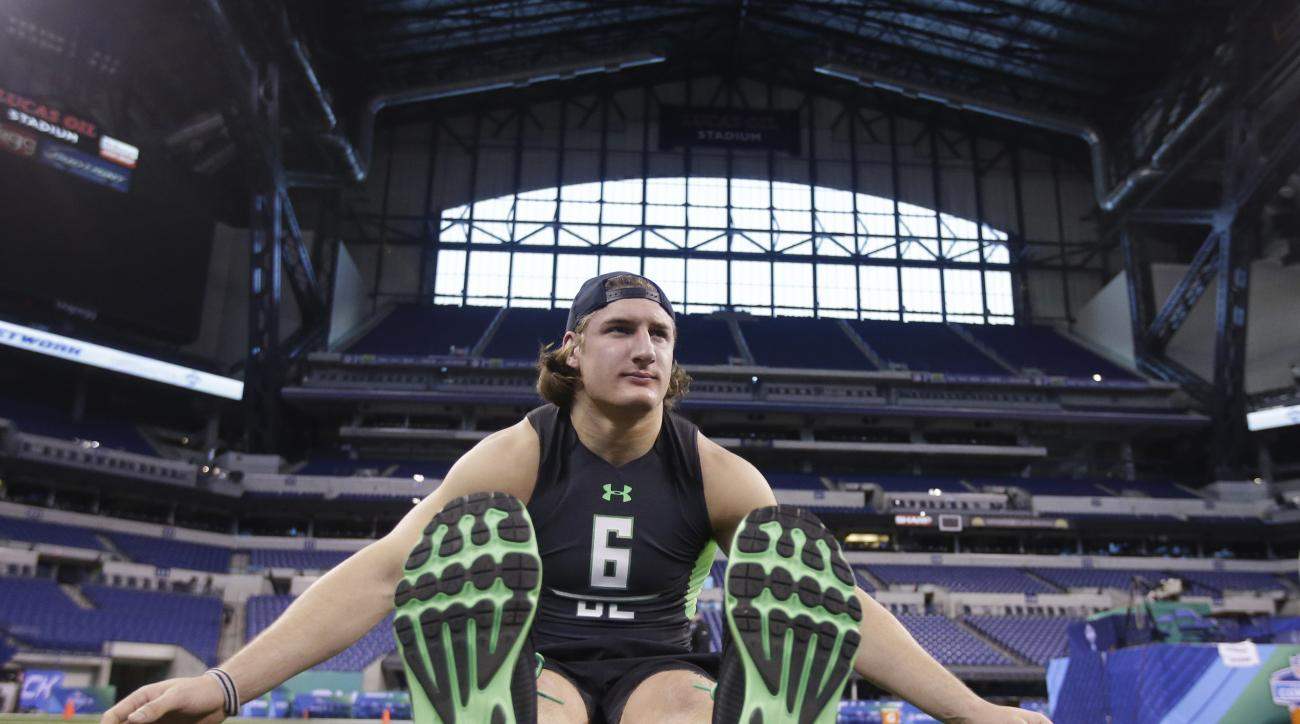 Ohio State defensive lineman Joey Bosa stretches at the NFL football scouting combine on Sunday, Feb. 28, 2016, in Indianapolis. (AP Photo/Darron Cummings)