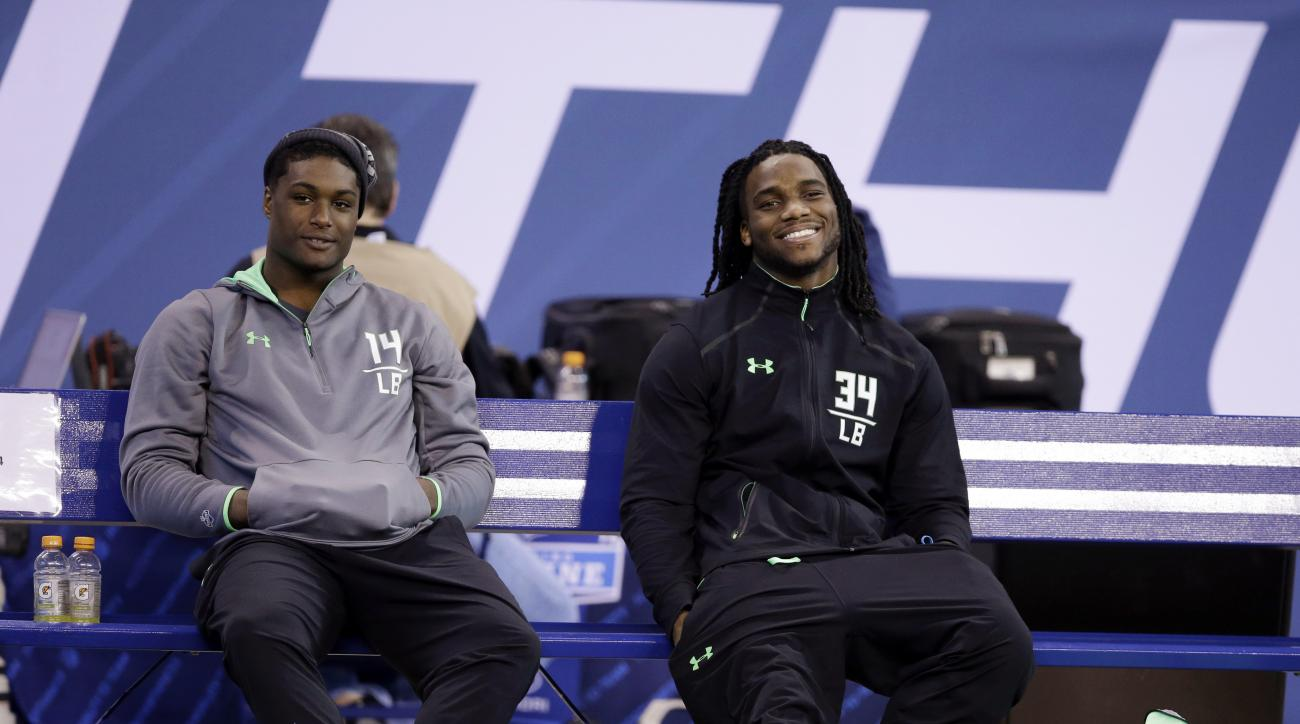 UCLA linebacker Myles Jack, left, and Notre Dame linebacker Jaylon Smith watch during drills at the NFL football scouting combine on Sunday, Feb. 28, 2016, in Indianapolis. (AP Photo/Darron Cummings)