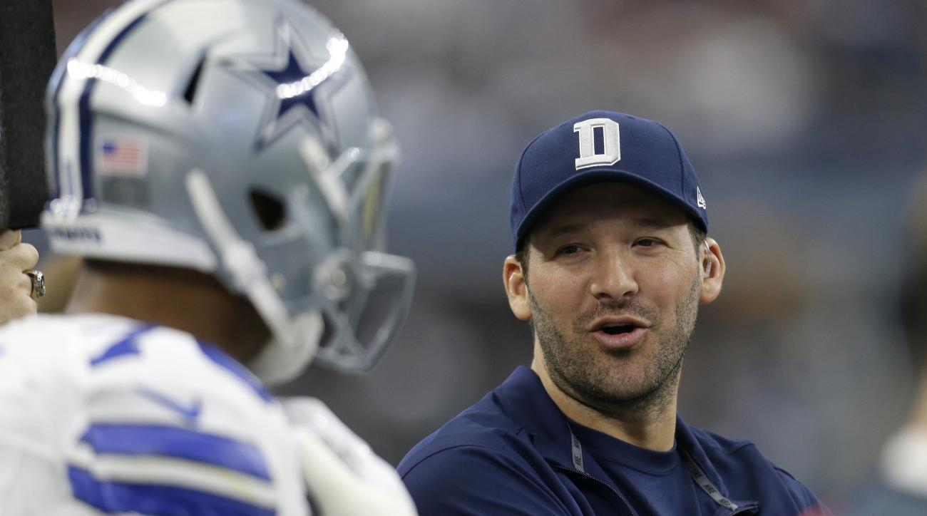 In this Sunday, Jan. 3, 2016 photo, Dallas Cowboys' Tony Romo talks with teammates on the sideline in the first half of an NFL football game against the Washington Redskins in Arlington, Texas. A judge has dismissed a major element of a lawsuit filed agai