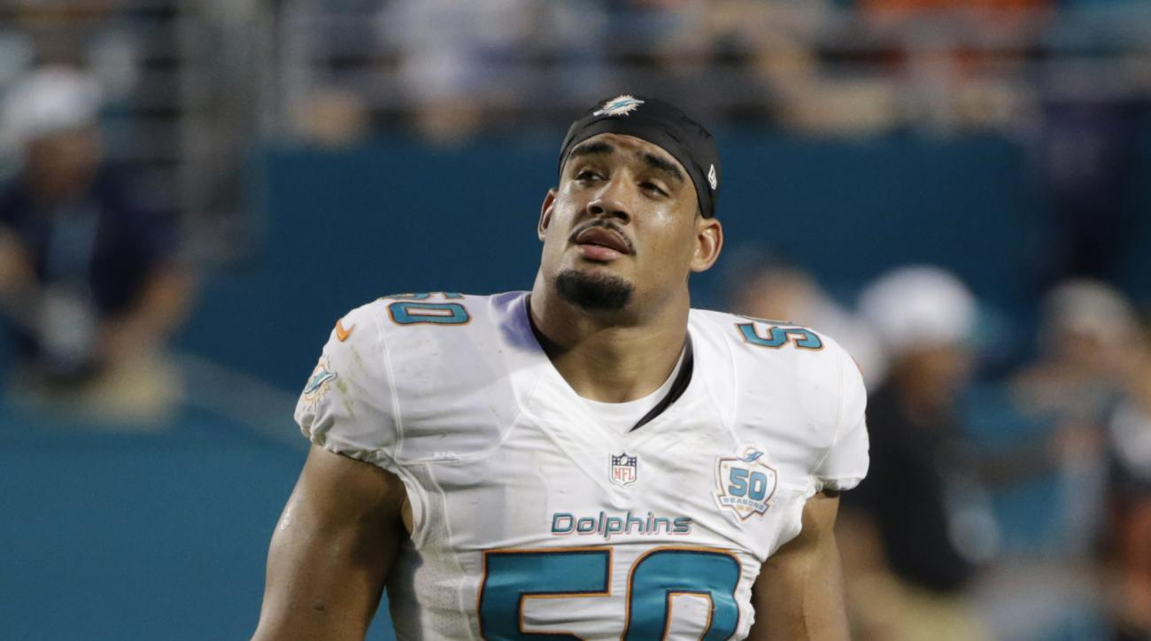Miami Dolphins defensive end Olivier Vernon (50) walks off the field during the second half of an NFL football game against the Buffalo Bills, Sunday, Sept. 27, 2015 in Miami Gardens, Fla. (AP Photo/Wilfredo Lee)