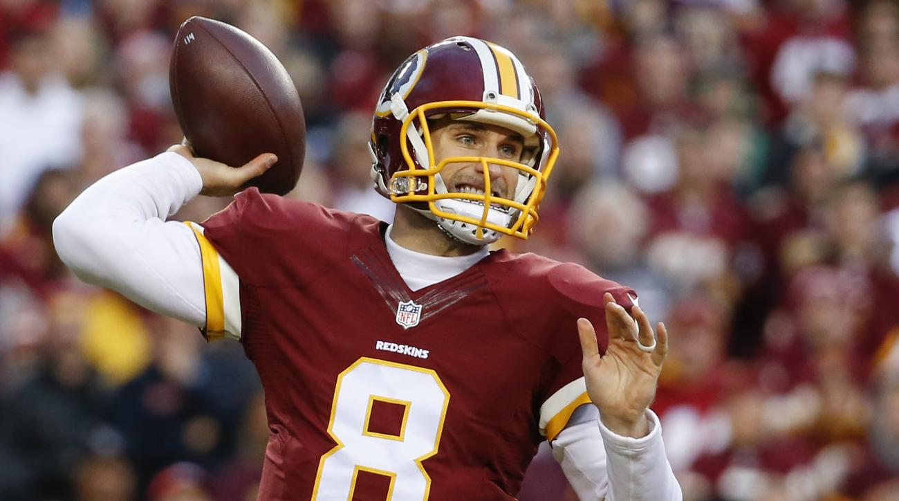 FILE - In this Jan. 10,  2016 file photo, Washington Redskins quarterback Kirk Cousins (8) passes the ball during the first half of an NFL wild card playoff football game against the Green Bay Packers in Landover, Md. The Washington Redskins have placed t