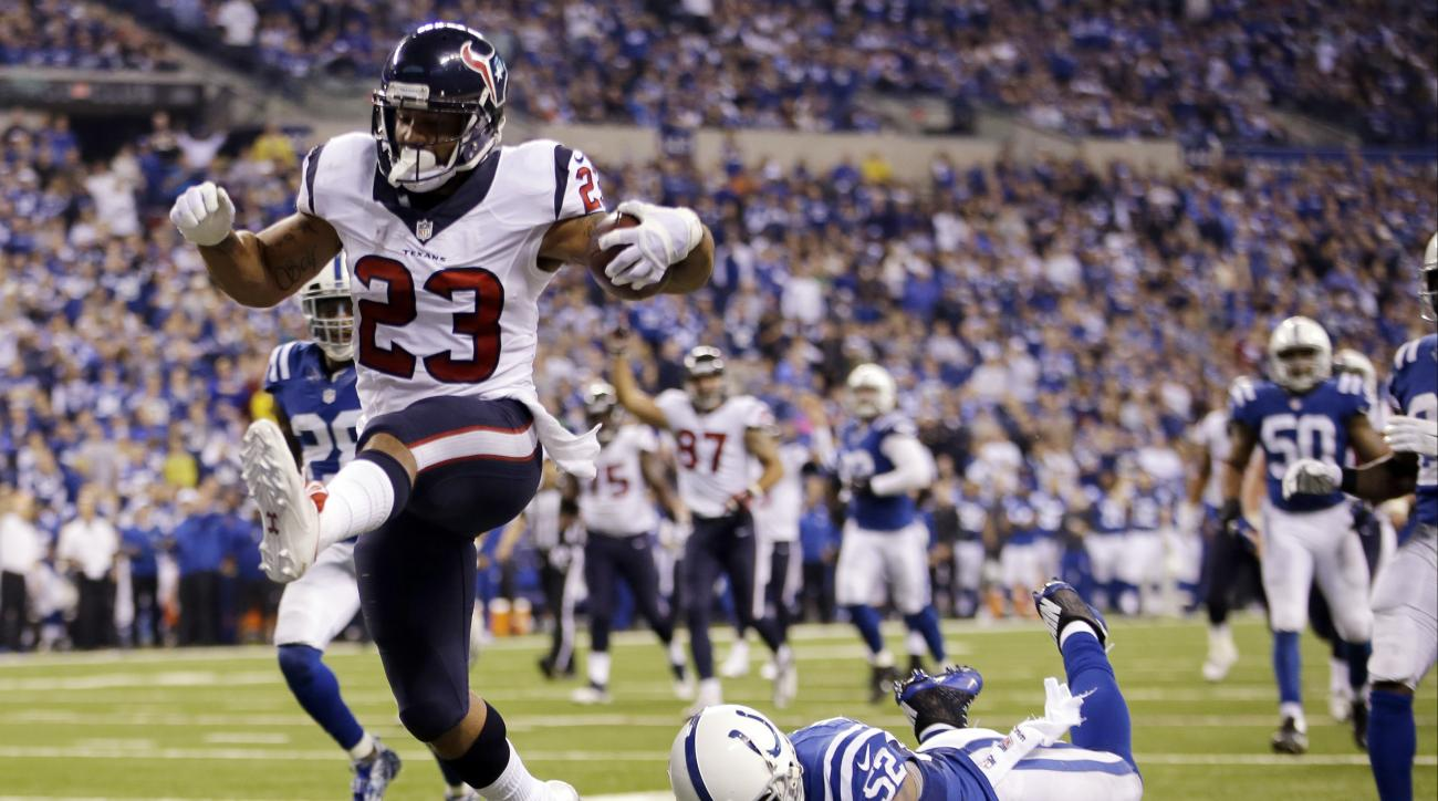 FILE - In this Dec. 14, 2014, file photo, Houston Texans running back Arian Foster (23) gets past the Houston Texans middle linebacker Jeff Tarpinian during the second half of an NFL football game in Indianapolis. The four-time Pro Bowler was released  by