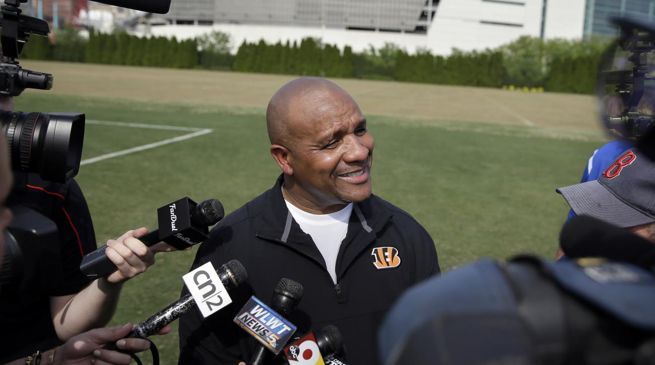 FILE - In this May 8, 2015, file photo, Cincinnati Bengals NFL football offensive coordinator Hue Jackson speaks to reporters outside Paul Brown Stadium following a rookie minicamp in Cincinnati. New Cleveland Browns coach Hue Jackson said the team is 'no