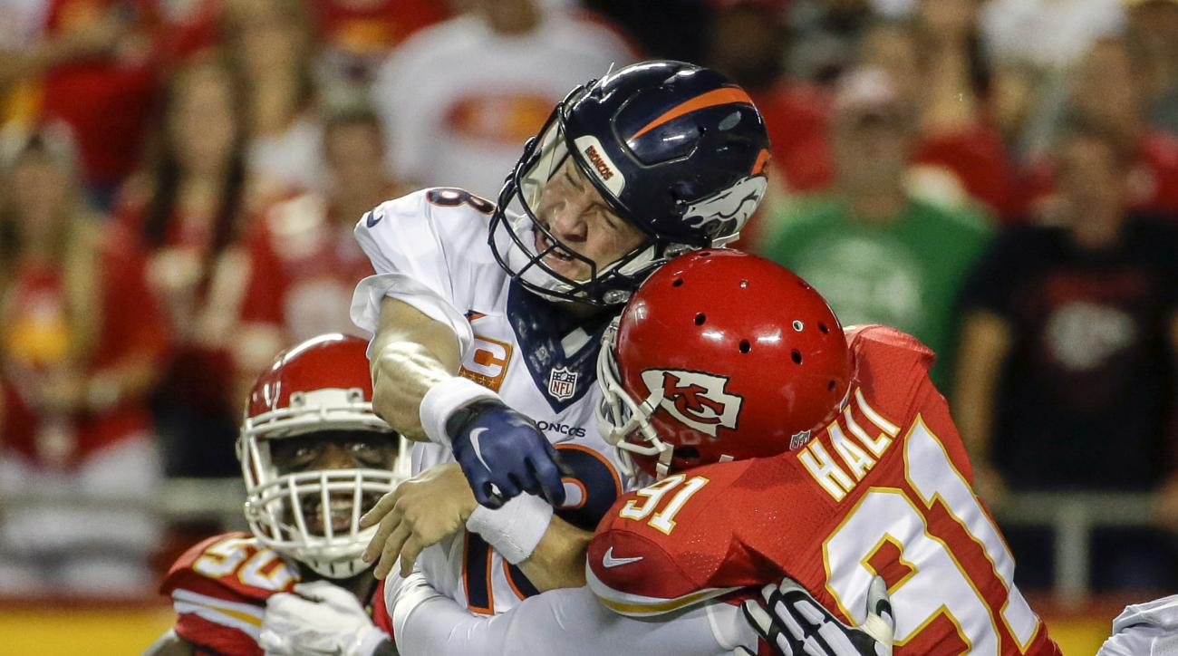 FILE - In this Thursday, Sept. 17, 2015 file photo, Kansas City Chiefs linebacker Tamba Hali (91)] makes contact with Denver Broncos quarterback Peyton Manning (18) after the throw, in the first half of an NFL football game in Kansas City, Mo. (AP Photo/C