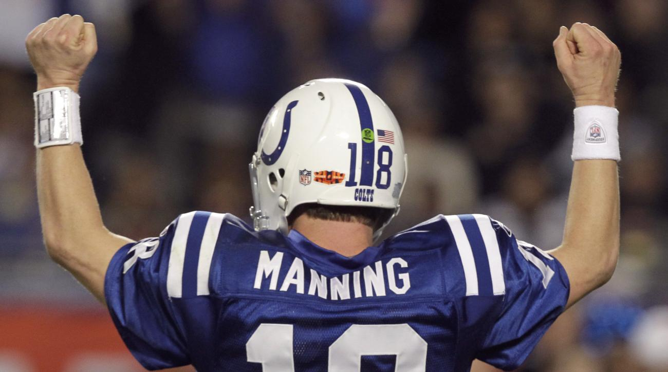 FILE - In this Feb. 7, 2010, file photo, Indianapolis Colts quarterback Peyton Manning celebrates after teammate Joseph Addai scored a touchdown during the second half of the NFL Super Bowl XLIV football game against the New Orleans Saints in Miami. A per