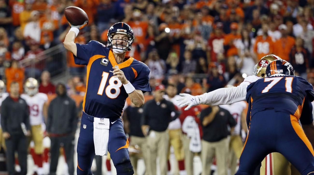 FILE - In this Oct. 19, 2014, file photo, Denver Broncos quarterback Peyton Manning throws his 509th career touchdown pass to set the all time record during the first half of an NFL football game against the San Francisco 49ers, in Denver. Manning's recei