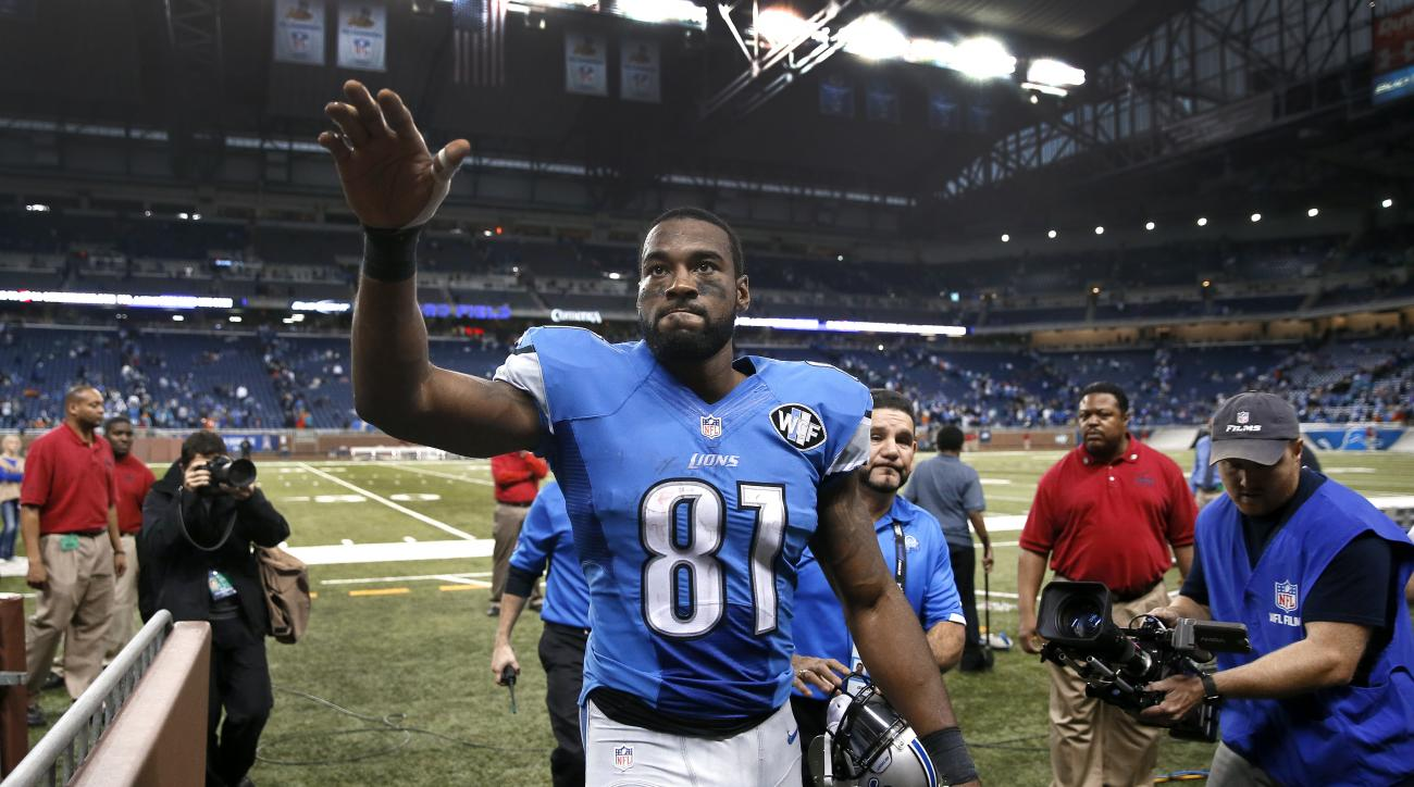 FILE - In this Nov. 9, 2014, file photo, Detroit Lions wide receiver Calvin Johnson waves to fans after defeating the Miami Dolphins 20-16 in a NFL football game in Detroit. Calvin Johnson has retired. The 30-year-old receiver, known as Megatron, announce