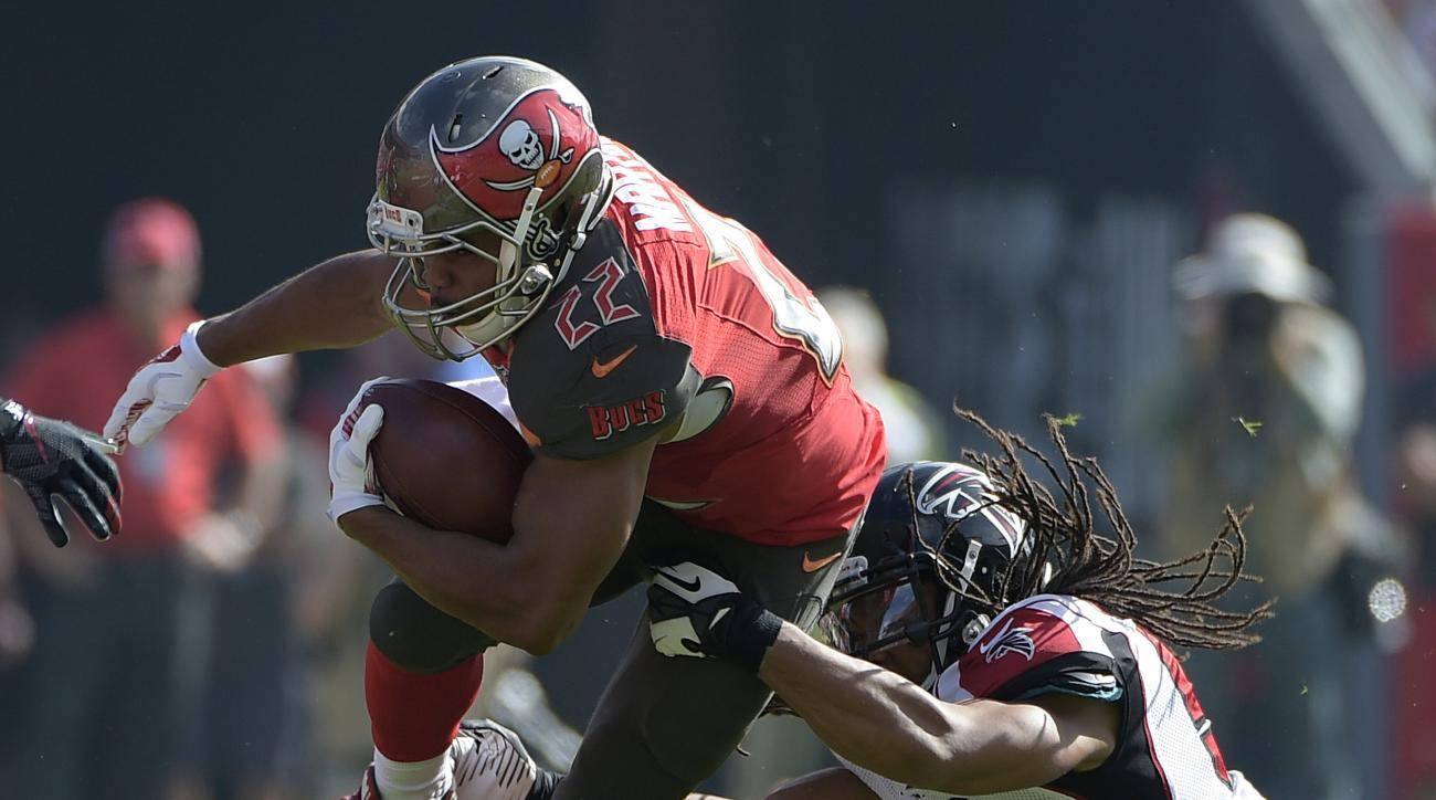 FILE - In this Dec. 6, 2015, file photo, Tampa Bay Buccaneers running back Doug Martin (22) is stopped by Atlanta Falcons outside linebacker Philip Wheeler (51) during the first quarter of an NFL football game in Tampa, Fla. The one All-Pro seemingly head