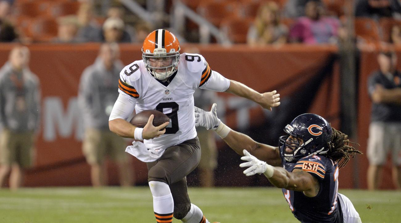 FILE - In this Aug. 28, 2014, file photo, Cleveland Browns quarterback Connor Shaw (9) runs away from Chicago Bears defensive end Austen Lane in the fourth quarter of a  preseason NFL football game in Cleveland. Cleveland did not release Manziel on Wednes