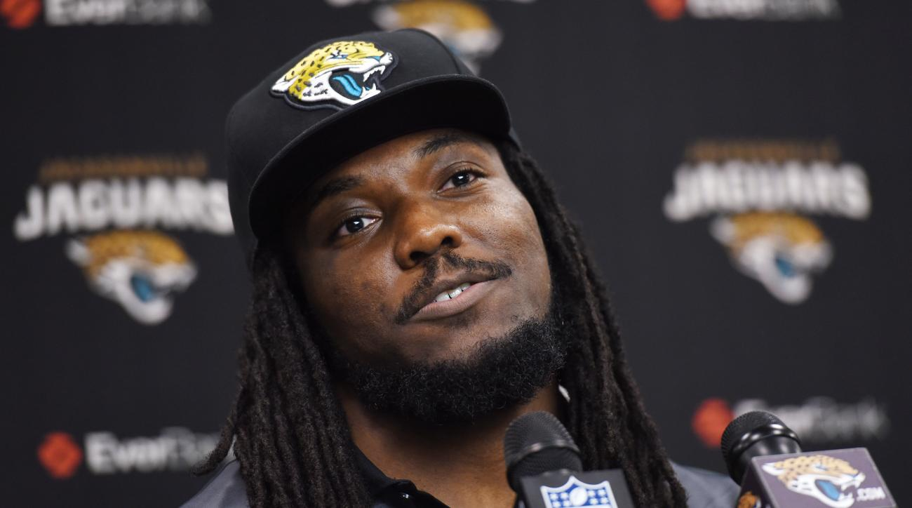 Former New York Jets running back Chris Ivory speaks at a press conference after signing with the Jacksonville Jaguars NFL football team in Jacksonville, Fla., Thursday, March 10, 2016. Ivory, who ran for 1,070 yards and seven touchdowns last season, sign