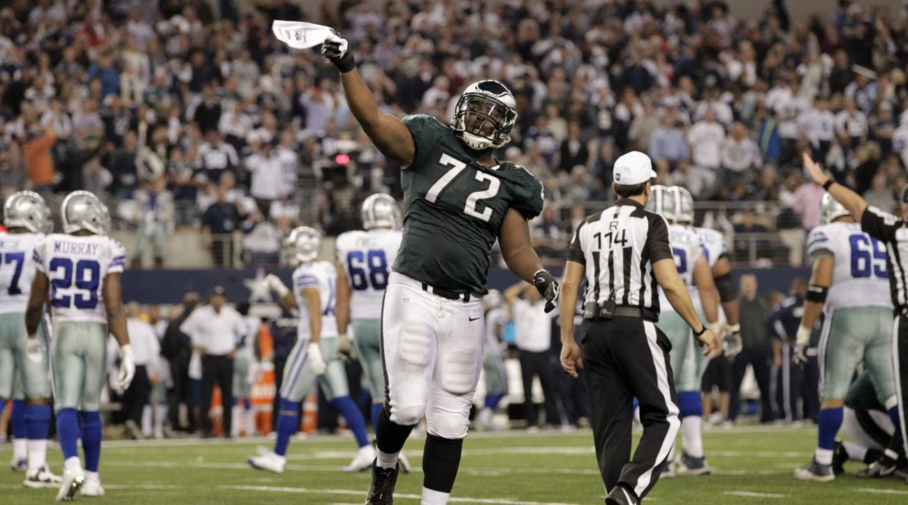 FILE - In this Dec. 29, 2013 file photo, Philadelphia Eagles defensive end Cedric Thornton (72) celebrates after cornerback Brandon Boykin intercepted the ball from Dallas Cowboys quarterback Kyle Orton during the second half of an NFL football game, in A