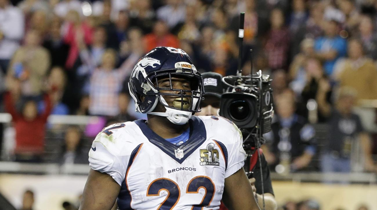 Denver Broncos'  C.J. Anderson (22) celebrates after his touchdown against the Carolina Panthers during the second half of the NFL Super Bowl 50 football game Sunday, Feb. 7, 2016, in Santa Clara, Calif. (AP Photo/Jae C. Hong)