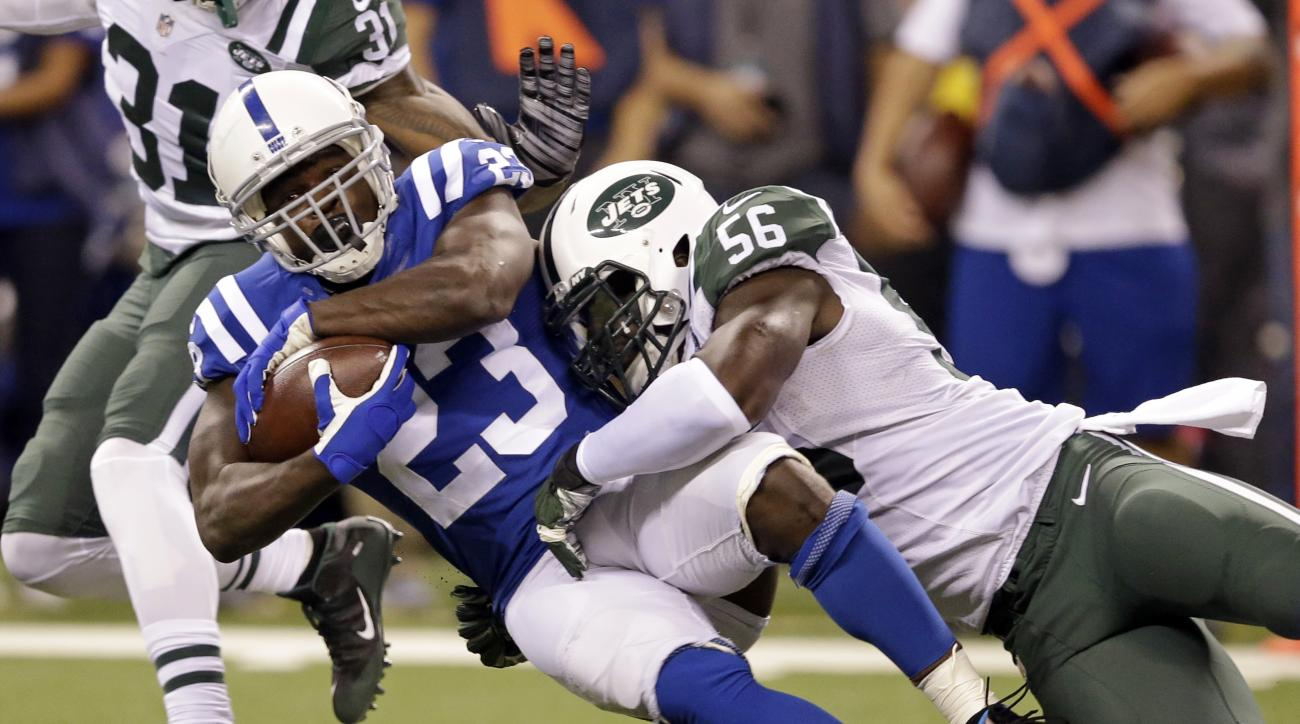 FILE - In this Sept. 21, 2015, file photo, New York Jets inside linebacker Demario Davis (56) tackles Indianapolis Colts running back Frank Gore (23) in the first half of an NFL football game in Indianapolis. A person familiar with the negotiations says t