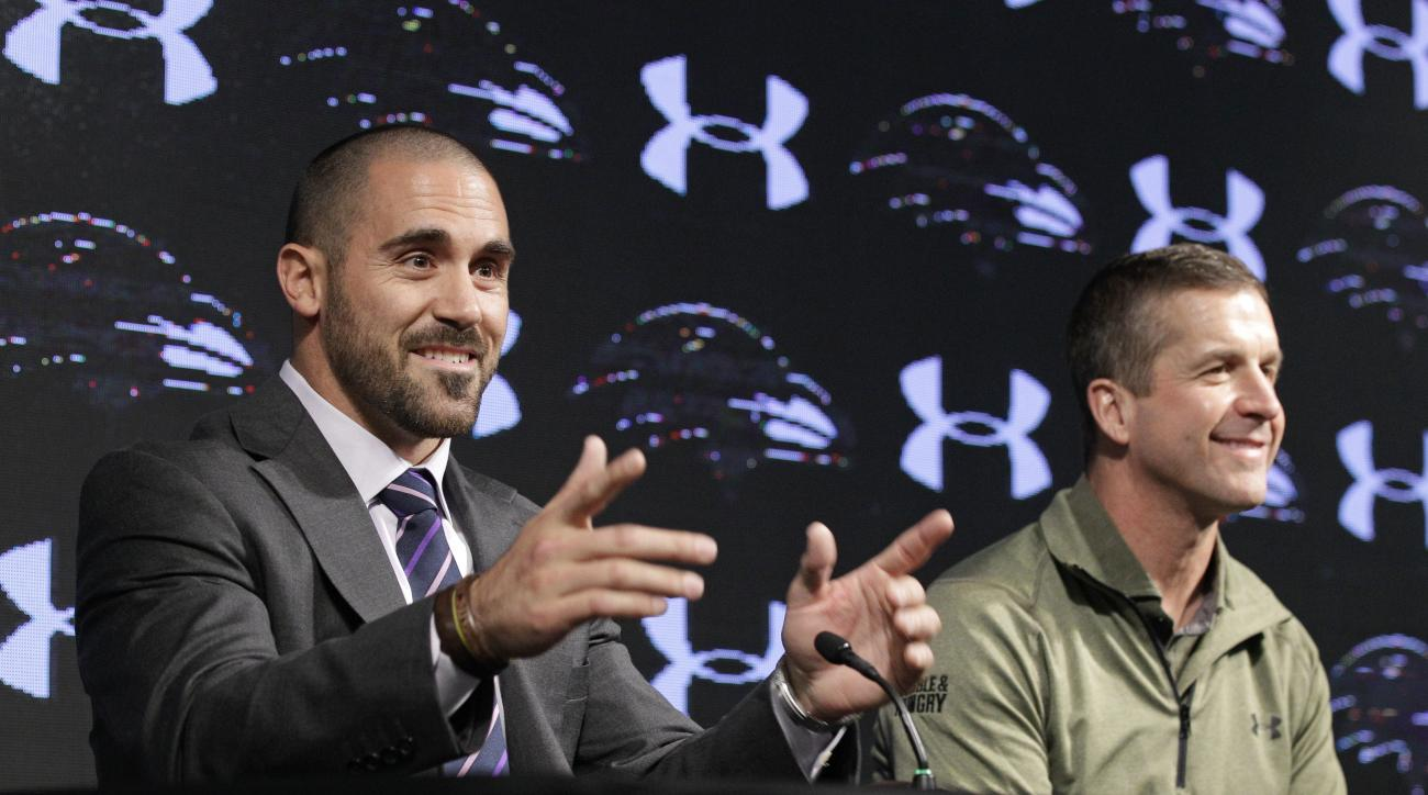 Baltimore Ravens' newly-signed safety Eric Weddle, left, speaks alongside head coach John Harbaugh during an NFL football news conference at the team's practice facility, Wednesday, March 16, 2016, in Owings Mills, Md. Weddle comes to Baltimore after spen
