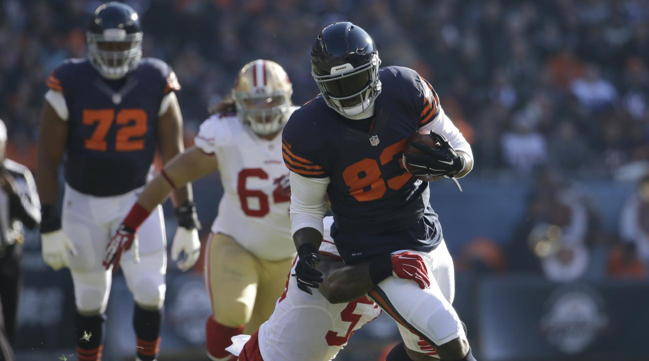 Chicago Bears tight end Martellus Bennett (83) is tackled by San Francisco 49ers inside linebacker NaVorro Bowman (53)during the first half of an NFL football game, Sunday, Dec. 6, 2015, in Chicago. (AP Photo/Nam Y. Huh)