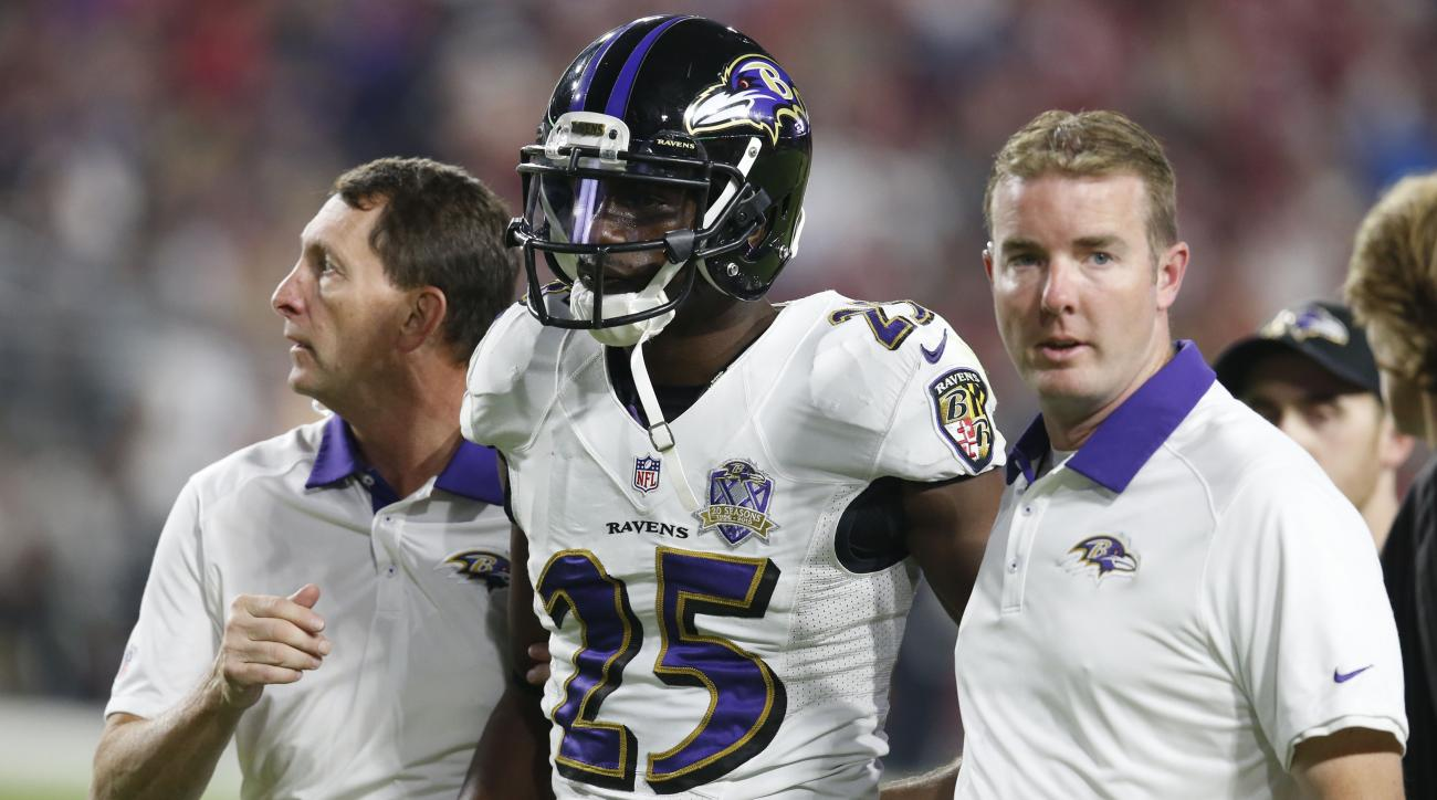 FILE - This Oct. 26, 2015, file photo shows Baltimore Ravens cornerback Tray Walker (25) during the second half of an NFL football game in Glendale, Ariz. Walker is in critical condition after being involved in motorcycle accident. The Ravens said Thursda