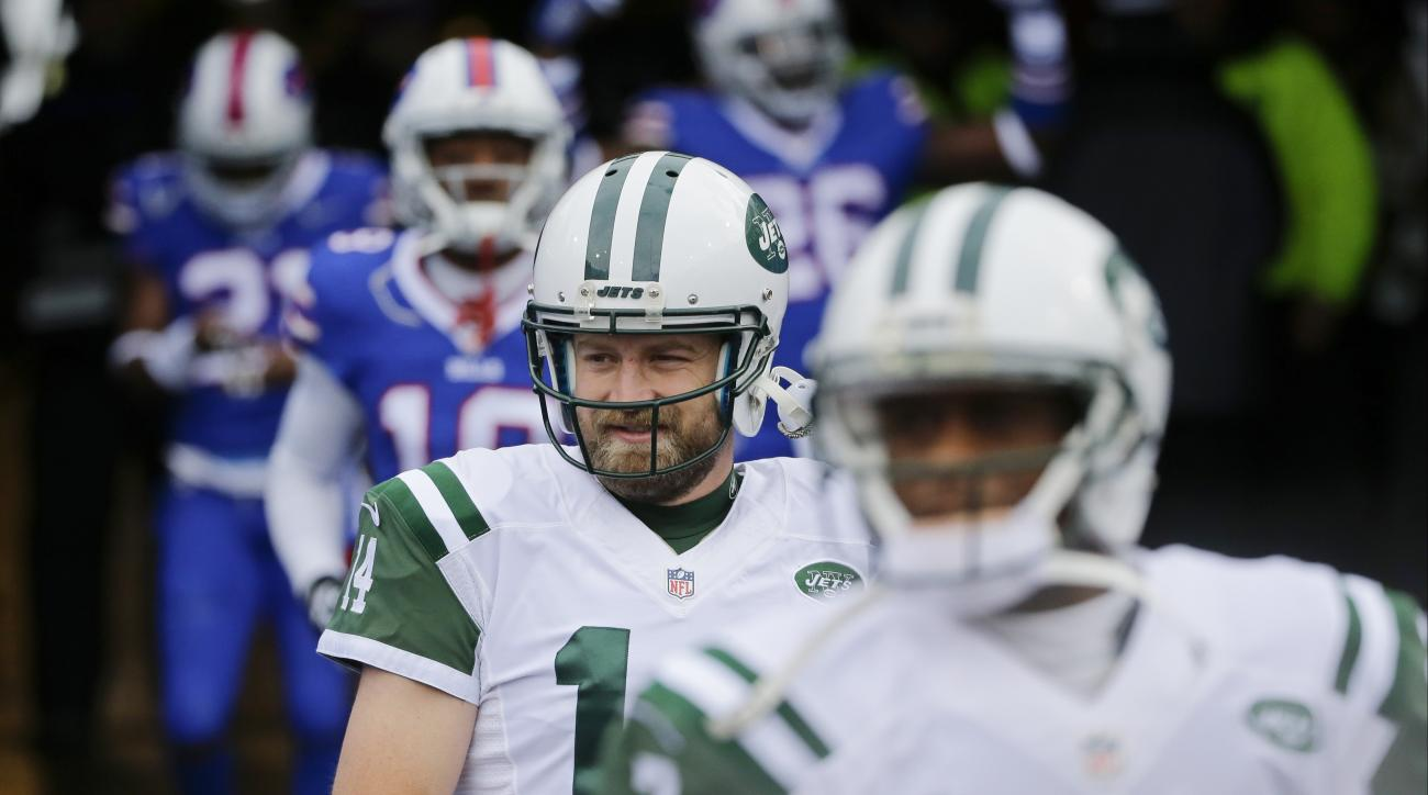 FILE - In this Jan. 3, 2016, file photo, New York Jets quarterback Ryan Fitzpatrick (14) and teammate Geno Smith (7) walk on the field to warm up before an NFL football game against the Buffalo Bills in Orchard Park, N.Y. New York Jets general manager Mik