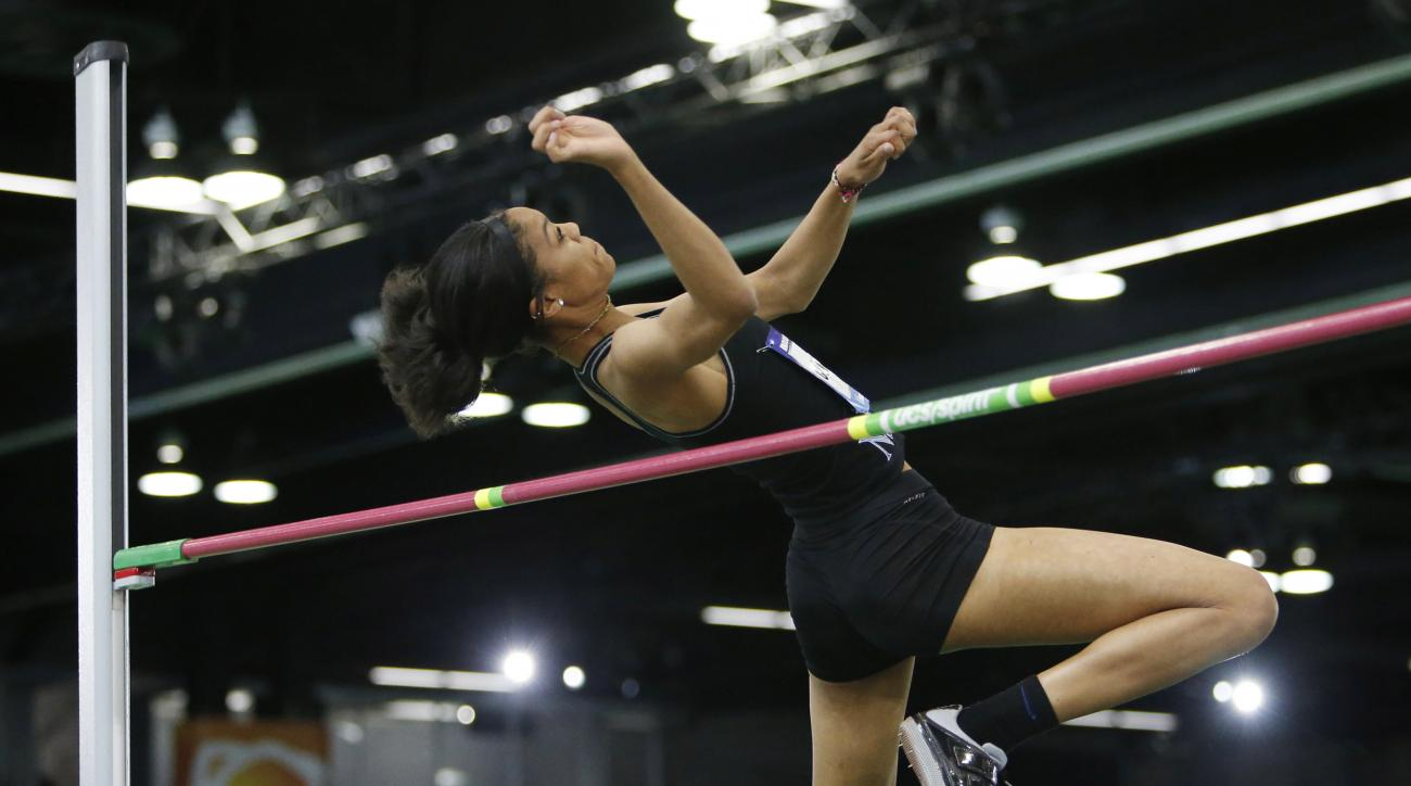 FILE - In this Saturday, March 12, 2016 file photo, Vashti Cunningham clears a height in the women's high jump at the U.S. indoor track and field championships in Portland, Ore. Cunningham, 18, is competing in the high jump at the U.S. indoor track and fi