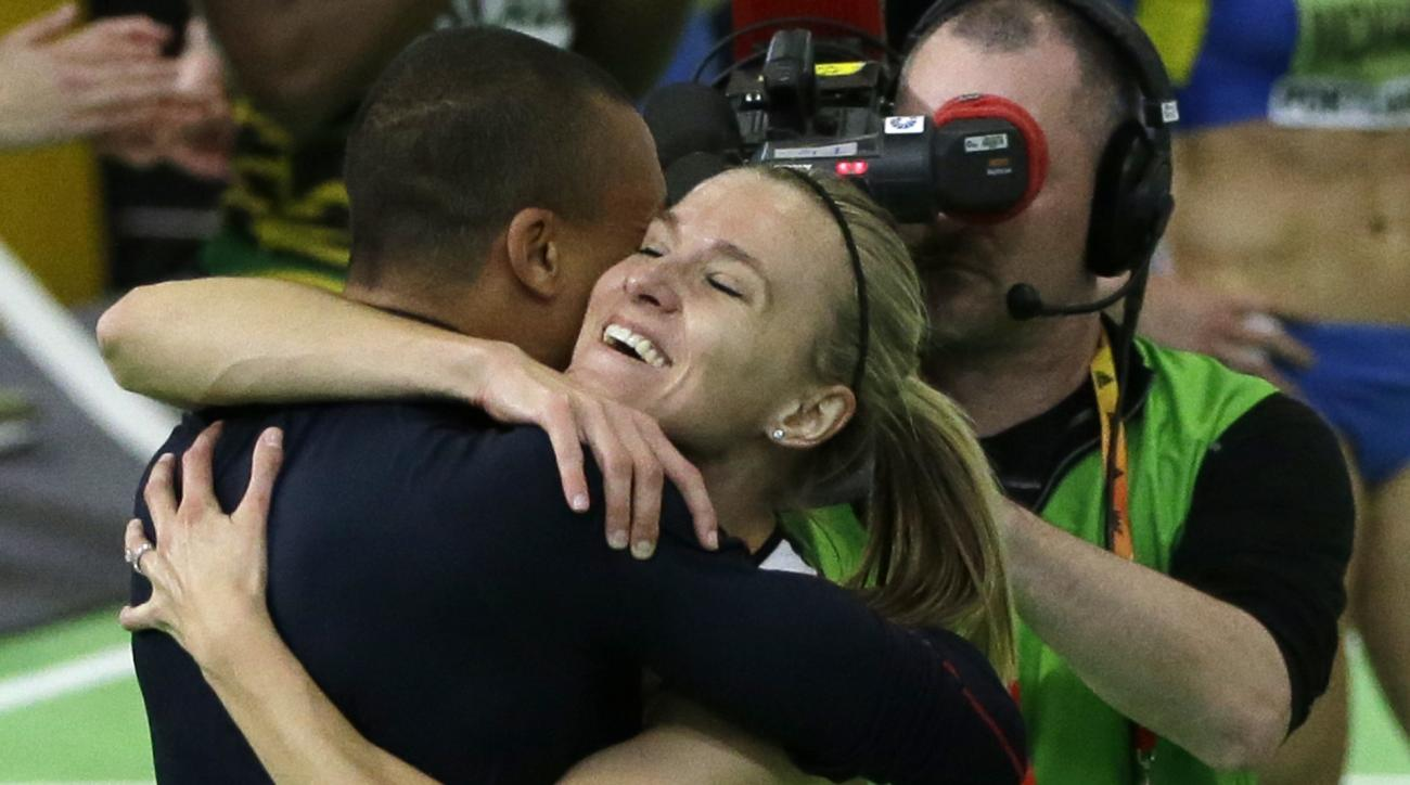United States' Ashton Eaton, left, hugs his wife, Canada's Brianne Theisen Eaton after she won the women's 800-meter sprint of the pentathlon and the overall pentathlon event during the World Indoor Athletics Championships, Friday, March 18, 2016, in Port