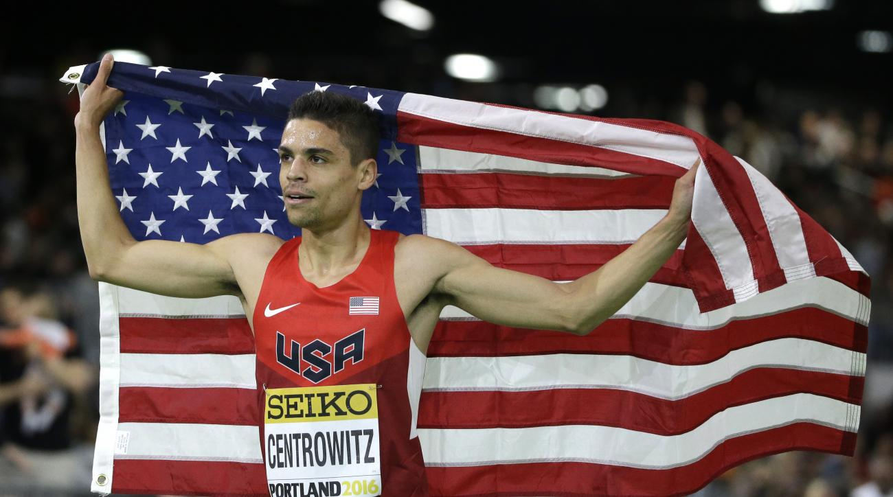 United States' Matthew Centrowitz holds the flag after he won the men's 1500-meter run final during the World Indoor Athletics Championships, Sunday, March 20, 2016, in Portland, Ore. (AP Photo/Rick Bowmer)