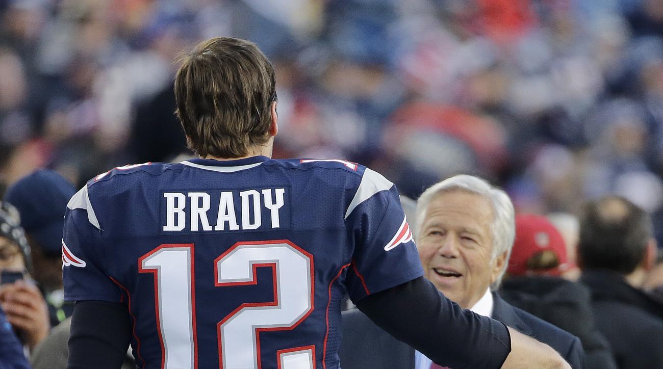 New England Patriots quarterback Tom Brady greets team owner Robert Kraft before an NFL divisional playoff football game against the Kansas City Chiefs, Saturday, Jan. 16, 2016, in Foxborough, Mass. (AP Photo/Elise Amendola)