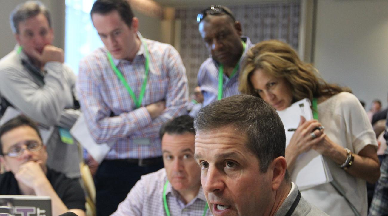 Baltimore Ravens football head coach John Harbaugh, right, talks to members of the media at the NFL owners meeting in Boca Raton, Fla., Tuesday, March 22, 2016. (AP Photo/Luis M. Alvarez)