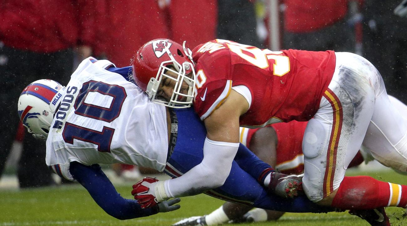 FILE - In this Nov. 29, 2015, file photo, Kansas City Chiefs linebacker Justin Houston (50) tackles Buffalo Bills wide receiver Robert Woods (10) during the first half of an NFL football game in Kansas City, Mo. Chiefs star pass rusher Justin Houston coul