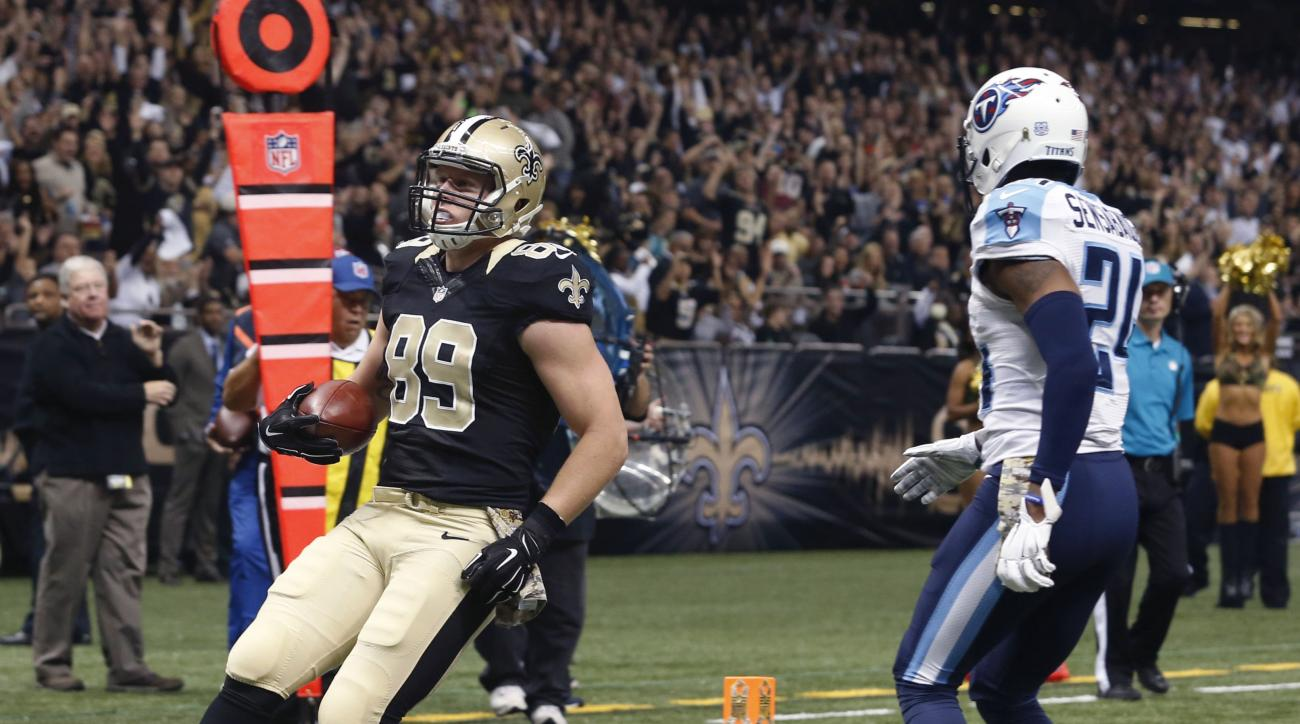 New Orleans Saints tight end Josh Hill (89) carries for a touchdown reception as Tennessee Titans cornerback Coty Sensabaugh (24) covers in the first half of an NFL football game in New Orleans, Sunday, Nov. 8, 2015. (AP Photo/Jonathan Bachman)