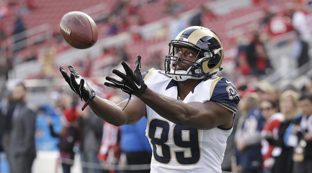 FILE - In this Jan. 3, 2016, file photo, St. Louis Rams tight end Jared Cook warms up before an NFL football game against the San Francisco 49ers in Santa Clara, Calif. The Green Bay Packers made a surprise move into free-agency by signing Cook on Monday,