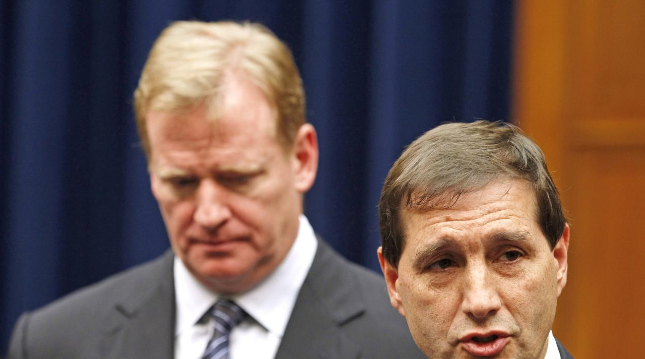 FILE - In this Oct. 14, 2011, file photo, NFL football lead counsel Jeff Pash, right, accompanied by NFL Commissioner Roger Goodell, speaks with reporters on Capitol Hill in Washington, after a meeting to discuss HGH testing for NFL players. The two NFL o