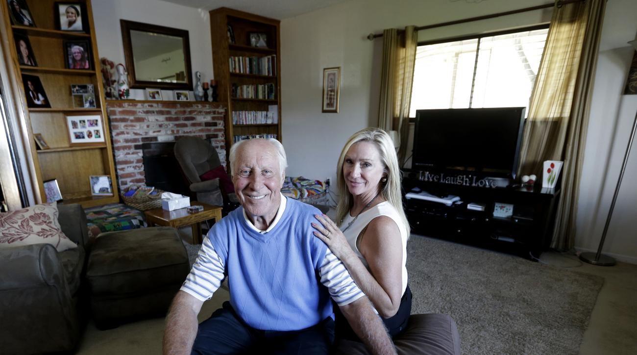 FILE - In this July 23, 2015 file photo, NFL Hall of Famer Fred Biletnikoff and his wife, Angela, pose in the living room of Tracey's Place of Hope in Loomis, Calif. The opportunity to reminisce and trade stories with old Raiders teammates is always one o