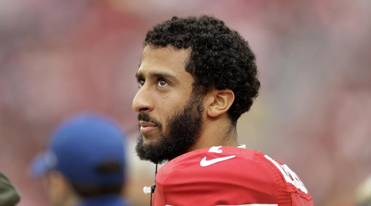 FILE - In this Nov. 8, 2015, file photo, San Francisco 49ers quarterback Colin Kaepernick stands on the field during an NFL football game against the Atlanta Falcons in Santa Clara, Calif. After months of trade talk and speculation, Kaepernick is still on